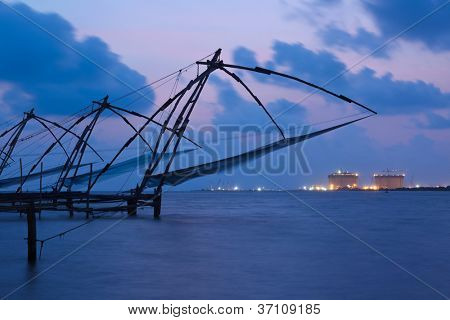 Kochi chinese fishnets in twilight. Fort Kochin, Kochi, Kerala, India