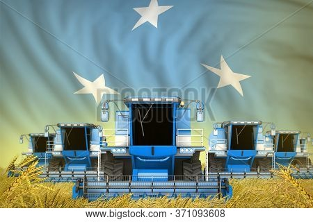 Some Blue Farming Combine Harvesters On Grain Field With Micronesia Flag Background - Front View, St