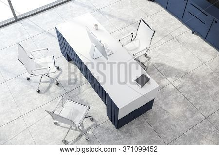 Top View Of Minimalistic Ceo Office With Wooden Walls, Tiled Floor And Original Blue Computer Desk.