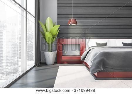 Front View Of Modern Master Bedroom With Gray And Wooden Walls, Concrete Floor, Comfortable King Siz