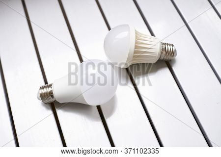 A Glass Bulb Inserted Into A Lamp Or A Socket In A Ceiling, That Provides Light By Passing An Electr