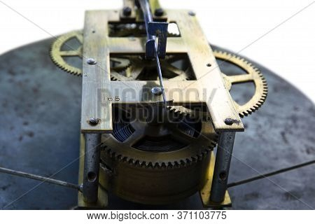 Old And Durable Wall Clock Mechanism. Mechanisms Are Just As Reliable. Close-up.