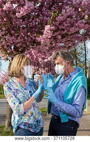 Senior Couple Wearing Surgical Face Masks.