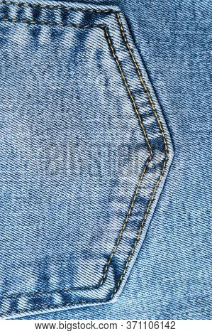 Close-up Pocket Of Denim Blue Fabric With Yellow Seams. Fashionable Jeans. Vertical Top View.
