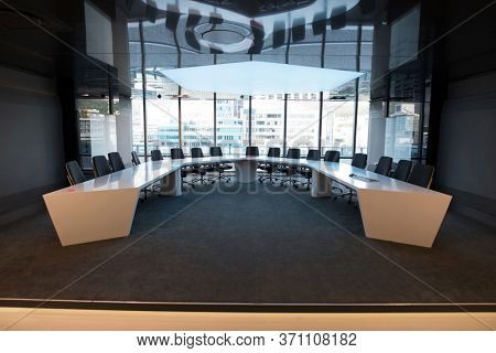 Empty chairs and table in boardroom
