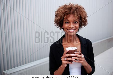 Pretty African American Executive With Mug