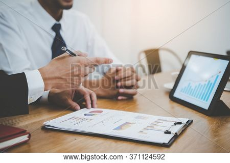 Financial Advisory Services. Asian Advisor Showing Plan Of Investment To Clients In The Consultancy