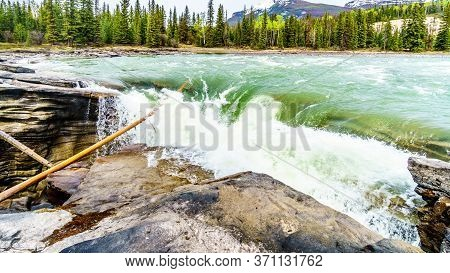 At The Athabasca Falls The Water Of The Athabasca River Pours The Hard Quartzite Layer Onto The Soft