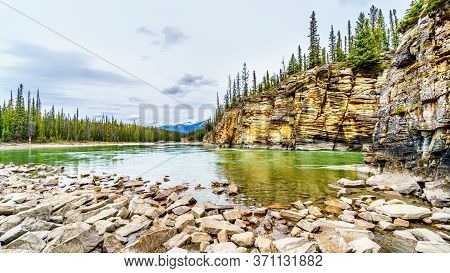 The Quiet Turquoise Water Of The Athabasca River Right After The Athabasca Falls In Jasper National