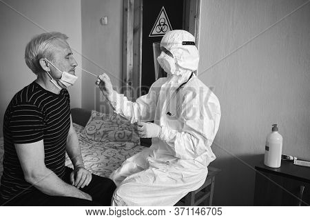 Black And White Snapshot Of A Doctors Examination At Home. Nurse Taking Coronavirus Test Analysis Wi