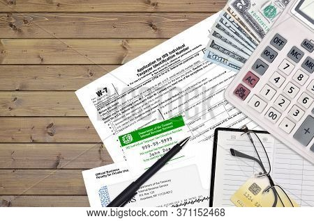Irs Form W-7 Application For Irs Individual Taxpayer Identification Number Lies On Flat Lay Office T