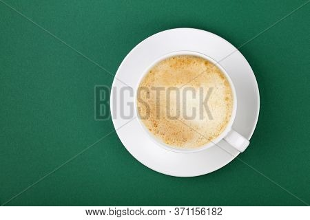 Close Up One Full White Cup Of Frothy Latte Cappuccino Coffee On Saucer On Green Table Background, E