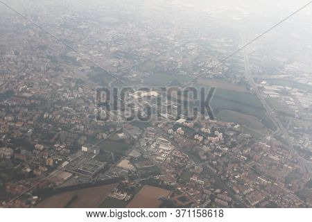 Top View Of European City In Grey Day With Clouds. Climate Change And Pollution Concept. Weather Con
