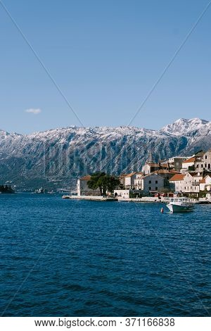 The City Of Perast Against The Backdrop Of Snow-capped Mountains.