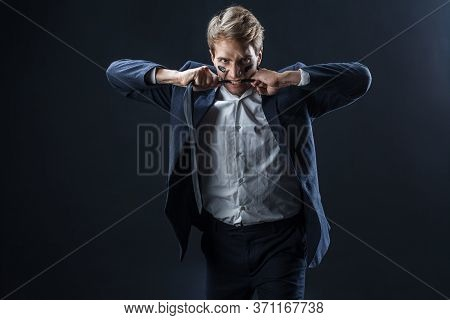 Young Man In A Business Suit Rolled Up His Sleeves And Boxing. Aggressive Business, Concept. Busines