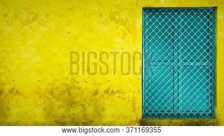 Yellow Wall With Copy Space And Colorful Window In India