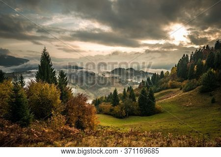 View Of Mountain Forest Sunrise With Dramatic Cloudy Sky On Background. Beautiful Landscape With Con