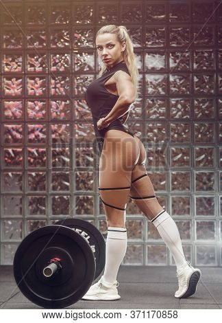 Fitness Woman Pumping Up Butt Booty Legs Muscles