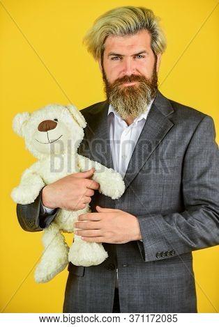 Friendly Relations. Imaginary Friend. Still Childish In Soul. Happy Businessman Hug Teddy Bear Yello