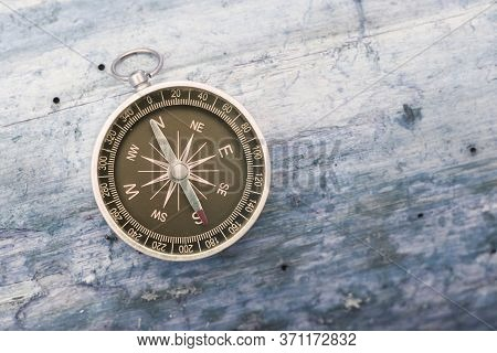 Round Compass On Blue Wooden Background As Symbol Of Tourism With Compass, Travel With Compass And O