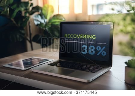 Recovery In Life Or Business Concept. Economic Crisis Symbolic. Progressive Bar Loading On Computer