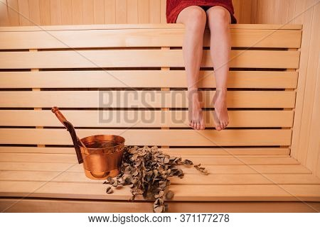 Beautiful Woman Relaxing In Sauna And Staying Healthy