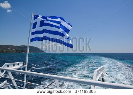 Greek Flag On Board A Cruise Boat Travelling Along Mount Athos Monasteries From Ouranoupolis Port, H