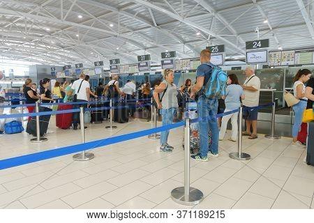 Passengers Pass Passport Control In Larnaca International Airport