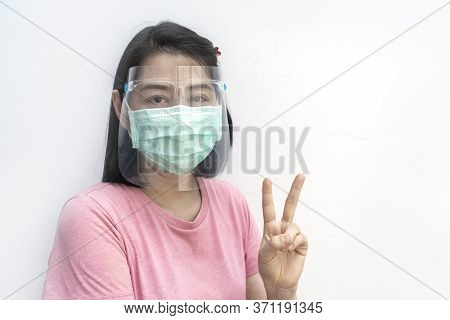 Isolated Portrait Of Asian Woman Wearing Medical Facial Mask And Face Shield On White Background, Sh