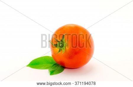Fresh Tomato With Leaf On White Background