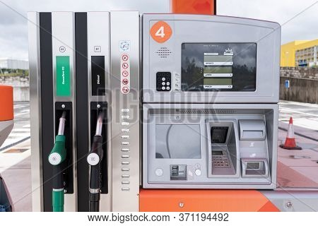 Fuel Pumps. Diesel And Gasoline Pistol On Self Service Petrol Pump. Spanish Text: Gasoline, Diesel