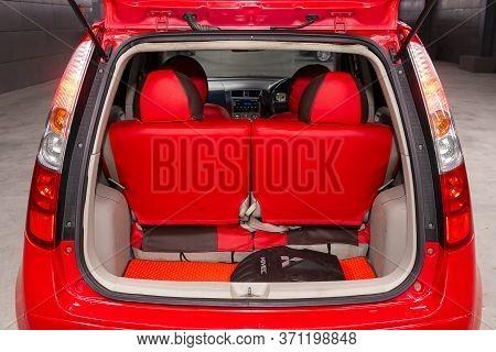 Novosibirsk/ Russia - June 03, 2020: Mitsubishi Colt, Close-up Of The Open Trunk, Headlight, Bumper,
