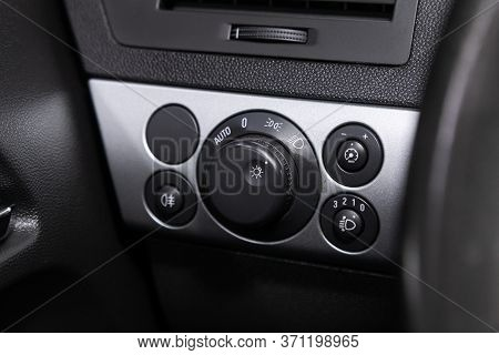 Novosibirsk/ Russia - June 03, 2020: Opel Astra, Close-up Of The  Headlight Setting Buttons. Modern