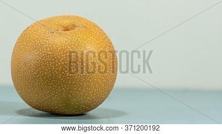 Fresh Fruit Of Pear-nashi, Nashi Or Náxi. Pear Of The Asian Variety (pyrus Pyrifolia). Natural Food.