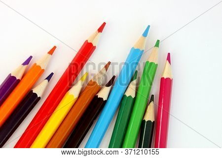 Colored Pencils On A White Background. Lots Of Different Colored Pencils. Colorful Pencil. Pencils A