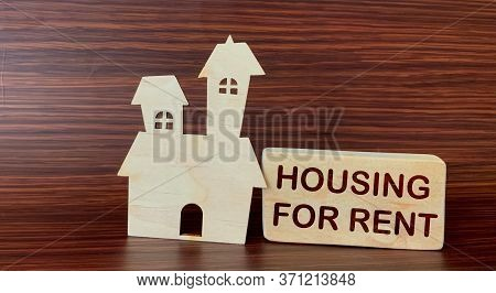 Wooden Cube With The Inscription Housing For Rent And House On A Wooden Background.photo For Real Es