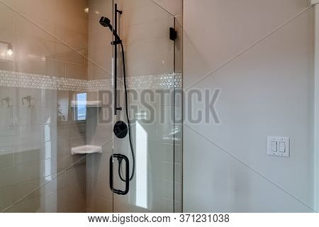 Shower Stall With Frameless Glass Enclosure And Hinged Door Inside Bathroom