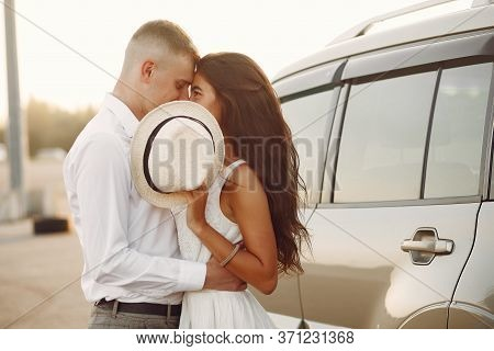 Beautiful Couple Spend Time In A Summer Park Near A Car