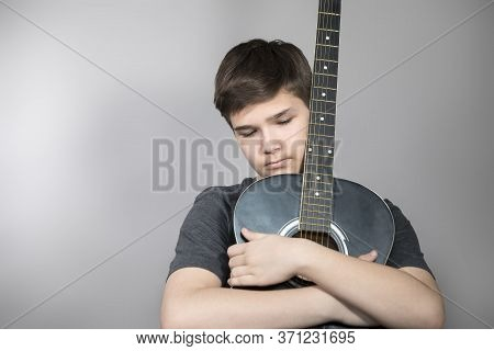 Teenager With Guitar, Young Musician. Teenager With Guitar, Young Musician. Portrait Of Serious Teen