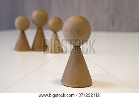 Wooden Pawns Concept Of Social Isolation, Bullying. Female Discrimination, Stalking And Violence Aga