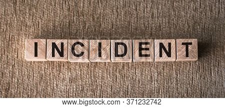 Incident Word Made Of Building Blocks On A Brown Texure Background