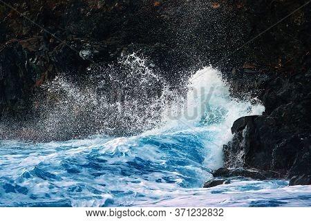 Ocean Waves Breaking On The Black Volcanic Cliffs, Stormy Day. Storm Season, Seascape. Waves Breakin