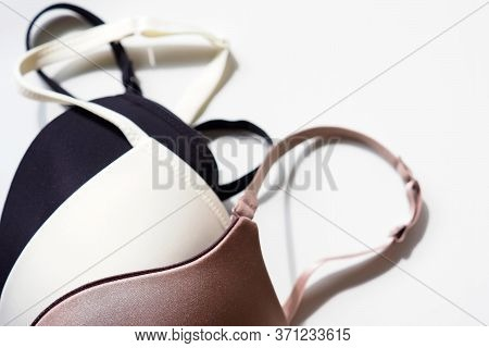 Stack Of Sexy Bras On White Background, Bra. Push Up Lingerie, Classic Colors: White, Black, Beige