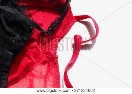 Women Underwear, Black And Red Corsages Or Corsets On White Background, Erotic Lingerie