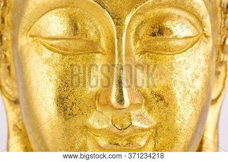 Gold Buddha Portrait, Macro Close Up Buddha Face Portrait, Closed Eyes Buddha.