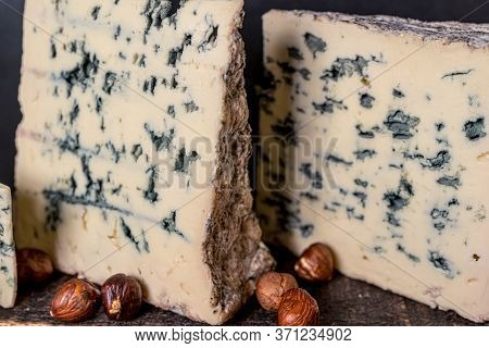 Cheese Roquefort. Rustic Closeup On Soft Black Background. Healthy Food Background.