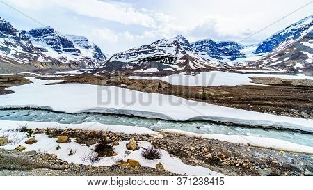 Glacial Water From The Athabasca Glacier And Dome Glacier In The Columbia Icefields Flowing Into The