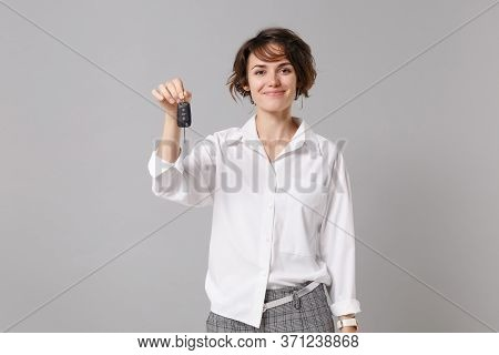 Smiling Beautiful Young Business Woman In White Shirt Posing Isolated On Grey Wall Background Studio