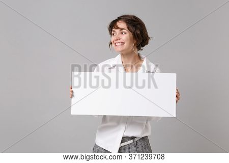 Smiling Young Business Woman In White Shirt Isolated On Grey Background. Achievement Career Wealth B