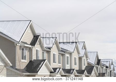 Townhouses With Snowy Gable Roofs In South Jordan Utah On A Cloudy Winter Day